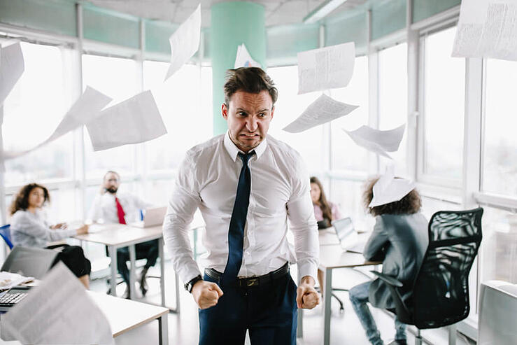 businessman angry about something i.e translation review