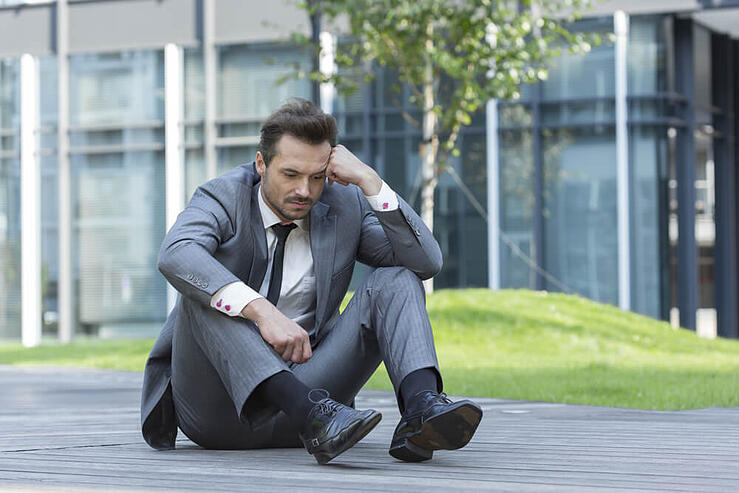businessman unhappy about his business growth failure due to poor website translation